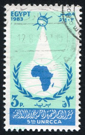 abjad: EGYPT - CIRCA 1983: stamp printed by Egypt, shows Emblem, Map of Africa, Globe, Satellite, circa 1983 Stock Photo