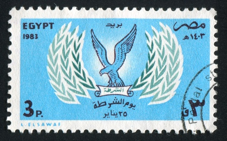 EGYPT - CIRCA 1983: stamp printed by Egypt, shows Arms, bird, circa 1983 photo