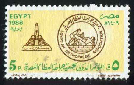 abjad: EGYPT - CIRCA 1988: stamp printed by Egypt, shows Egypt orthopaedic association emblem, circa 1988