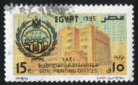 EGYPT - CIRCA 1988: stamp printed by Egypt, shows Emblem, building, ancient signs, circa 1988 photo