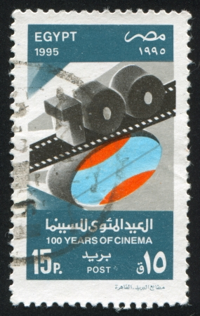 EGYPT - CIRCA 1995: stamp printed by Egypt, shows Stylized film with digits, circa 1995 photo