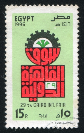 stratification: EGYPT - CIRCA 1996: stamp printed by Egypt, shows Emblem, Cogwheel, Inscription, circa 1996 Stock Photo