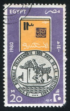 EGYPT - CIRCA 1980: stamp printed by Egypt, shows Emblem with map and ancient boat, circa 1980 Stock Photo - 14174295
