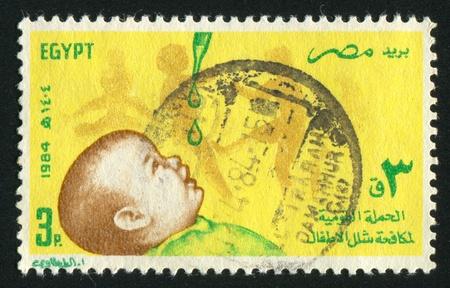 polio: EGYPT - CIRCA 1984: stamp printed by Egypt, shows Child, vaccine drops, circa 1984