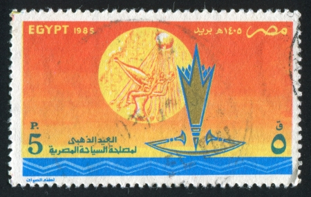 abjad: EGYPT - CIRCA 1985: stamp printed by Egypt, shows Boat, woman, sun, rays, circa 1985