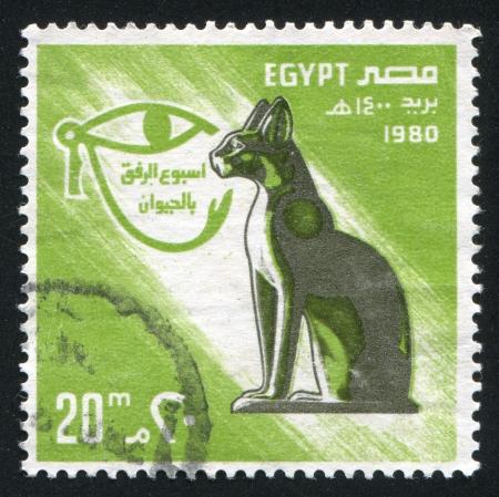 abjad: EGYPT - CIRCA 1980: stamp printed by Egypt, shows Cat, Eye sign, circa 1980 Stock Photo
