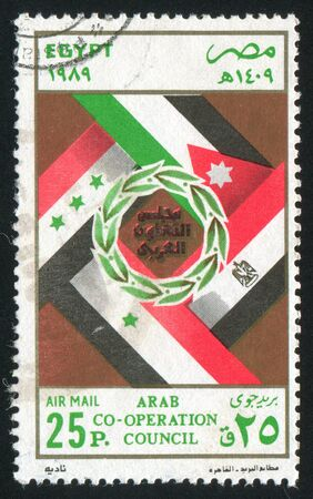 EGYPT - CIRCA 1989: stamp printed by Egypt, shows Flags, arms, circa 1989 photo