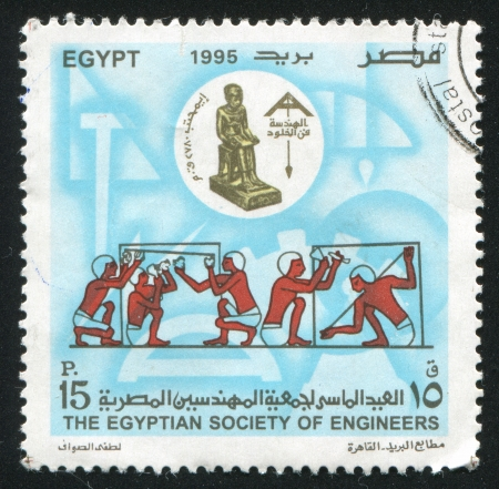 EGYPT - CIRCA 1995: stamp printed by Egypt, shows Workers, Statue, circa 1995 photo