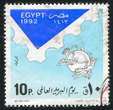 EGYPT - CIRCA 1992: stamp printed by Egypt, shows Postmark, Globe, Nymphs, circa 1992 photo