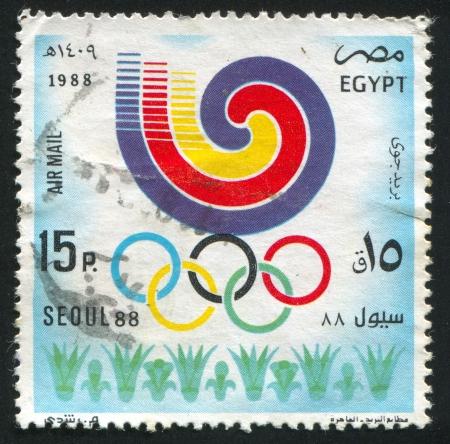 abjad: EGYPT - CIRCA 1988: stamp printed by Egypt, shows Olympic emblem, circa 1988