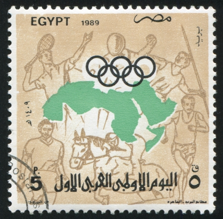 EGYPT - CIRCA 1989: stamp printed by Egypt, shows Olympic emblem, Map, Sportsmans, circa 1989