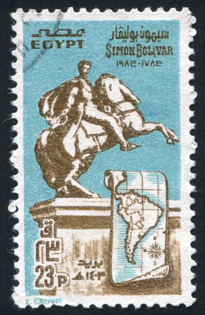 EGYPT - CIRCA 1983: stamp printed by Egypt, shows Simon Bolivar monument, Map of South America, circa 1983 photo
