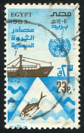 EGYPT - CIRCA 1983: stamp printed by Egypt, shows Ship, fish, circa 1983 photo