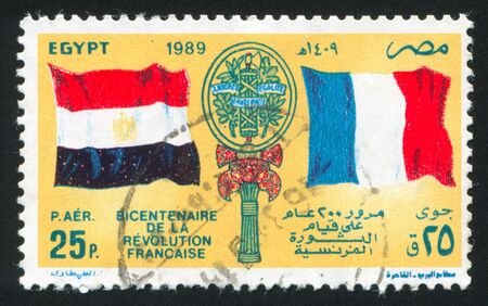 egypt revolution: EGYPT - CIRCA 1989: stamp printed by Egypt, shows Flags, arms, circa 1989