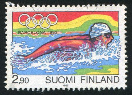 piscina olimpica: FINLANDIA - CIRCA 1992: sello impreso por Finlandia, muestra nadador, Barcelona, ??alrededor de 1992