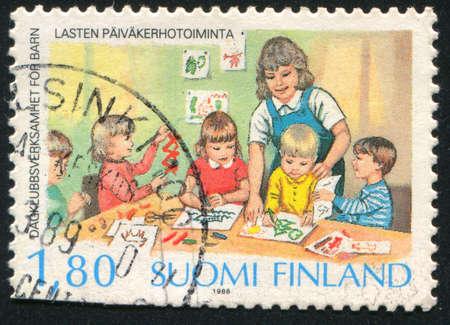 FINLAND - CIRCA 1988: stamp printed by Finland, shows Children Playgrounds (Preschool), circa 1988 Stock Photo - 14173195