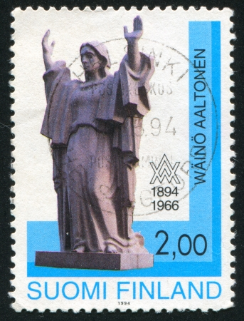 FINLAND - CIRCA 1994: stamp printed by Finland, shows Peace by Waino Aaltonen (1894-1966), circa 1994 photo