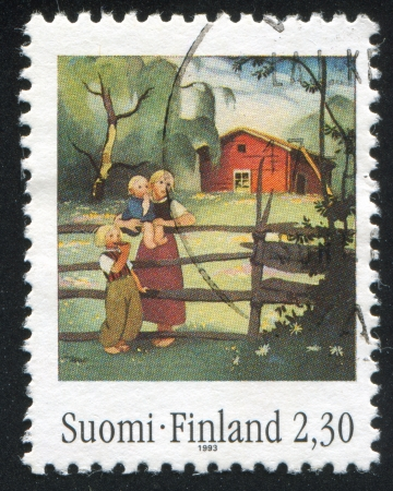 FINLAND - CIRCA 1993: stamp printed by Finland, shows Mother, children at fence by Martta Wendelin , circa 1993 photo