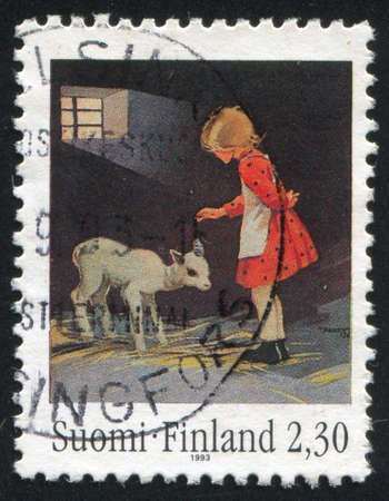 FINLAND - CIRCA 1993: stamp printed by Finland, shows Girl with lamb by Martta Wendelin, circa 1993 photo