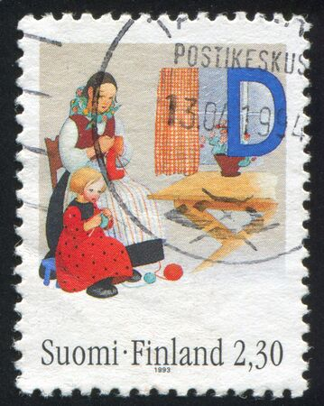 dwell: FINLAND - CIRCA 1993: stamp printed by Finland, shows Mother, daughter knitting by Martta Wendelin, circa 1993 Stock Photo