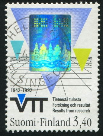 FINLAND - CIRCA 1992: stamp printed by Finland, shows Triangles and grid, circa 1992 photo