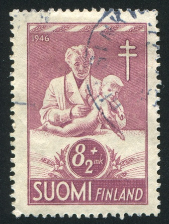 FINLAND - CIRCA 1946: stamp printed by Finland, shows Doctor Examining Child, circa 1946