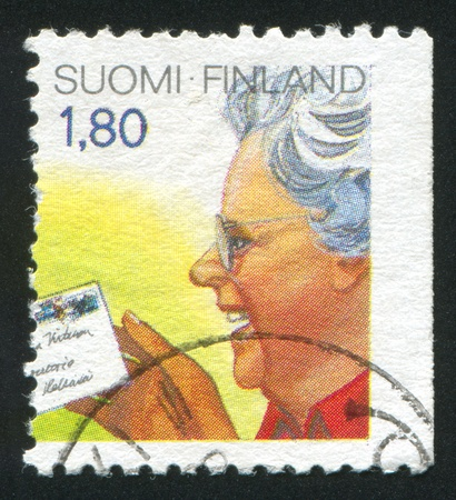 FINLAND - CIRCA 1988: stamp printed by Finland, shows Woman Reading Letter, circa 1988