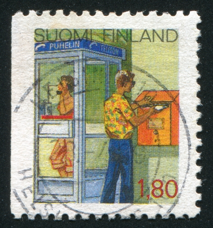 FINLAND - CIRCA 1988: stamp printed by Finland, shows Phone Booth and Man at Letter-box, circa 1988 photo