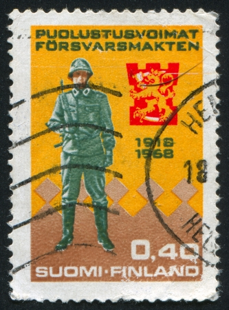 FINLAND - CIRCA 1968: stamp printed by Finland, shows Soldier of Present-Day Army, circa 1968 photo