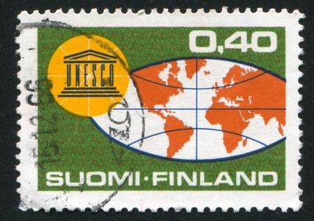 FINLAND - CIRCA 1966: stamp printed by Finland, shows Globe and Badge, circa 1966 photo