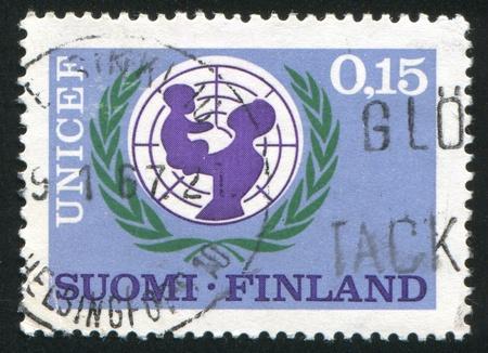 unicef: FINLANDIA - CIRCA 1966: timbro stampato dalla Finlandia, mostra UNICEF Emblem, circa 1966