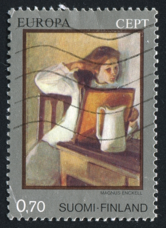 FINLAND - CIRCA 1975: stamp printed by Finland, shows Picture Girl Combing Hair by Magnus Enckell, circa 1975 photo