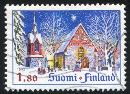 FINLAND - CIRCA 1992: stamp printed by Finland, shows Church of St Lawrence in Vantaa, circa 1992 photo