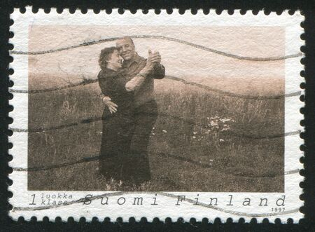 FINLAND - CIRCA 1997: stamp printed by Finland, shows Couple Dancing Tango, circa 1997