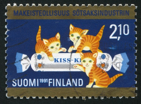 FINLAND - CIRCA 1991: stamp printed by Finland, shows Three Kittens and Candy, circa 1991 photo