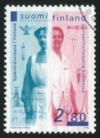 FINLAND - CIRCA 1998: stamp printed by Finland, shows Nurses, circa 1998
