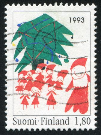 FINLAND - CIRCA 1993: stamp printed by Finland, shows Christmas Tree and Elves, circa 1993 photo