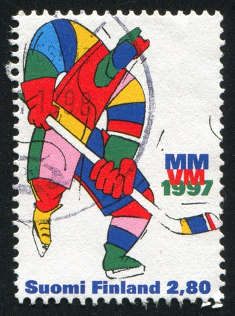 FINLAND - CIRCA 1997: stamp printed by Finland, Ice Hockey World Championships, Helsinki, circa 1997 photo