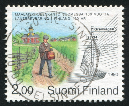 FINLAND - CIRCA 1990: stamp printed by Finland, shows Rural Postal Service and Address Reform, Northern Finland, circa 1990 photo