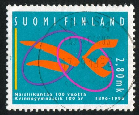 FINLAND - CIRCA 1995: stamp printed by Finland, shows Womens Gymnastics, circa 1995 photo