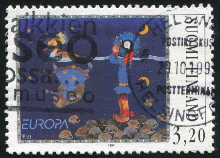 saami: FINLAND - CIRCA 1997: stamp printed by Finland, shows Saami Folktale, Girl Who Turned into a Golden Merganser, circa 1997 Stock Photo