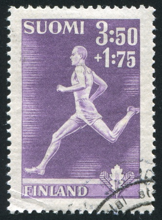 FINLAND - CIRCA 1945: stamp printed by Finland, shows Runner, circa 1945