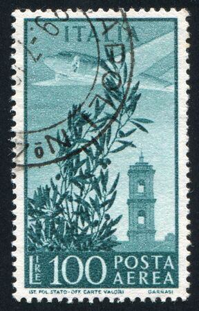 ITALY - CIRCA 1948: stamp printed by Italy, shows Plane over Capitol Bell Tower, circa 1948 photo