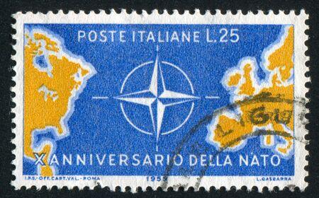 north atlantic treaty organization: ITALY - CIRCA 1959: stamp printed by Italy, shows Map of North Atlantic and NATO Emblem, circa 1959 Editorial