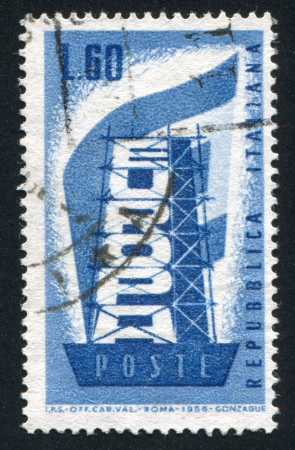 """redesign: ITALY - CIRCA 1956: stamp printed by Italy, shows """"Rebuilding Europe"""", circa 1956"""