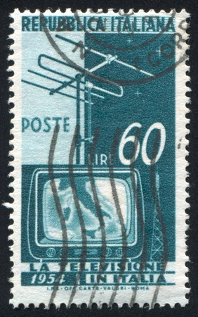 ITALY - CIRCA 1954: stamp printed by Italy, shows Television Screen and Aerial, circa 1954 photo