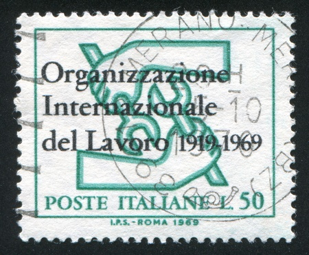 ITALY - CIRCA 1969: stamp printed by Italy, shows International Labour Organization (ILO) Emblem, circa 1969 photo