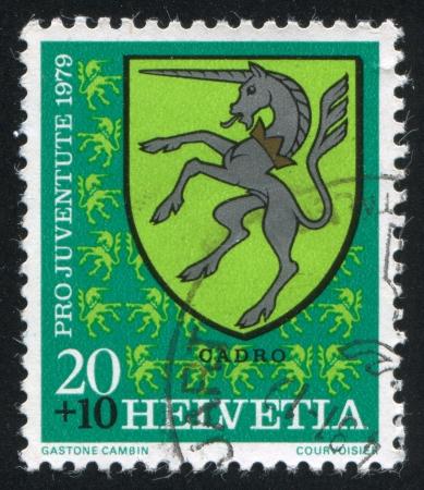 SWITZERLAND - CIRCA 1979: stamp printed by Switzerland, shows Cadro Arms, circa 1979. photo