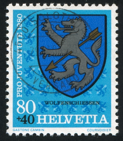 SWITZERLAND - CIRCA 1980: stamp printed by Switzerland, shows Wolfenschiessen Arms, circa 1980. photo
