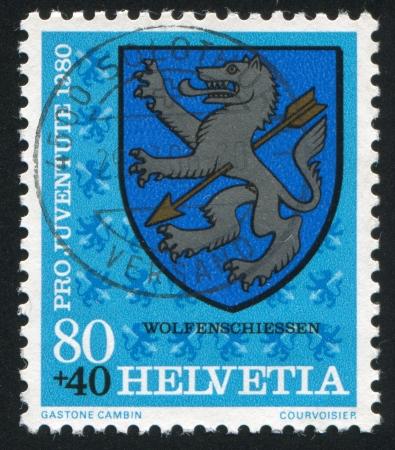 SWITZERLAND - CIRCA 1980: stamp printed by Switzerland, shows Wolfenschiessen Arms, circa 1980. Stock Photo - 14173325